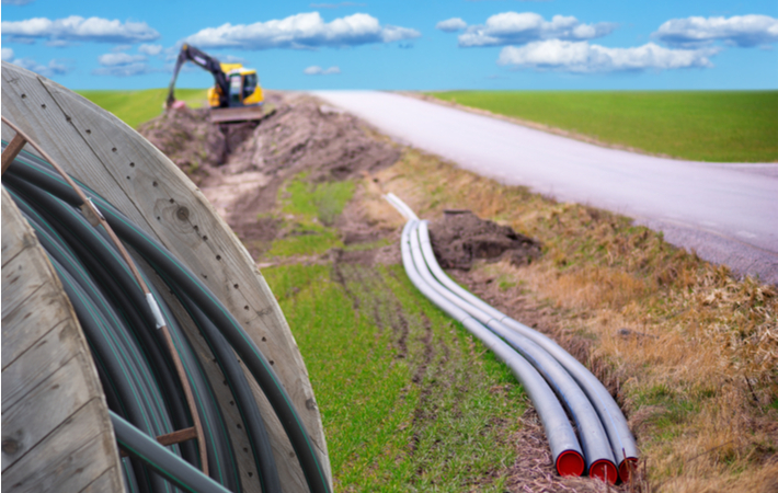 earth digger laying fiber optic internet cable